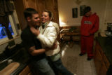 "Matthue (Matthue with a ""ue"") ""Budd"" Kible (CQ), 20, left, gets a hug from his..."