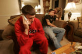 Christopher Lee Redlin, left, talks to his mother on the phone as fellow marine Matthue (Matthue...