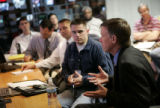 Denver Mayor John Hickenlooper (r) talks with airport operations personnel during a briefing about...