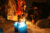 (DLM0323) -  Mario Trujillo, 21, of Denver wipes away a tear as he kneels at the memorial set up...