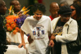 Darrent Williams' grandmother Easter Williams (center) walks away from the casket after viewing...