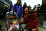 (DLM1439) -   James Parke, 26, gets a hug from his daughter Kaarina, 5, after she arrived from...