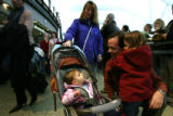 (DLM1441) -   James Parke, 26, gets a hug from his daughter Kaarina, 5, after she arrived from...