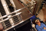 (DLM1899) -   Logan Crowell beds down for the night near the escalators leading up the ticketing...