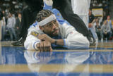 Allen Iverson gets stretched out pre-game as he suits up for the first time as a Denver Nugget at...