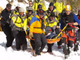 Rescue personnel bring up an avalanche survivor at Berthoud Pass on Saturday, January 6, 2007. An...