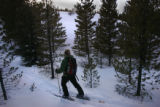 Sarah Steinbeck, ( cq) of Lakewood is off trail and looks at a slope to determine avalanche...