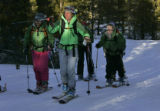 Leslie Ross, founder leads a group up a trail and gets ready to move off trail during a clinic...