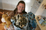 "Debbie Drury (cq) holds some of the ""goody bags"" in her home December 14, 2006. She..."