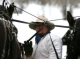 Walt Turner (cq) harnesses his horses in preparation of an afternoon sleigh ride Thursday December...