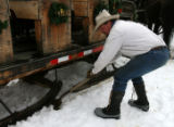 Walt Turner (cq) uses a shovel to break a sleigh free from the ice Thursday December 14, 2006 in...