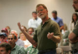 Joe Hunter, CQ, 61 speaks out during a public meeting for members of well augmentation...