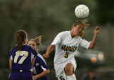 Arapahoe High School's Kelly Menachof gets underneath the ball against  Fort Collins' Olivia...