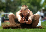 Alamosa's Dustin Bolt kicks up some sand as he lands in the pit during the Boys' 4A Long Jump at...