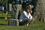 As the hours dragged on Prof Mimi Wesson rests by a tombstone and watches as the exhumation...