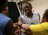 Nuggets draft candidate Antoine Hood of the Air Force Academy, laughs in a huddle at the end of...