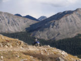An ATV rider makes his way up Tin Cup Pass just above the Colorado ghost towns St. Elmo and Tin...