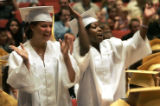 (L-R)  Crystal McClure (cq) 18, and Annette Oaks (cq) 17, soak in the moment as they cheer to...