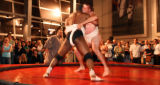 (Denver, Colo., May 19, 2006) Wrestlers battle in the ring, where one is victorious by forcing his...