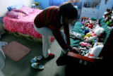 Victoria Hernandez, cq, 14, gets ready for dinner at home in Colorado Springs Sunday March 12,...