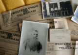 A photograph of Charles T. Strickland with old telegrams. Strickland who was originally from...