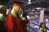 (Foreground then background LT. TO RT.) Brittany Daugherty (CQ), 18, of Colorado Springs, talks...