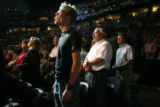 "Chad MacDonald of Lakewood sings ""God Bless America"" with 19,000 other attendees at the..."