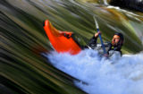 J.D. Dunlap (cq), 33, of Buena Vista paddles in the Salida Play Park one afternoon late in the...