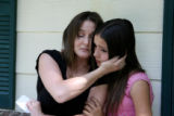 Ginny Gonzales, cq, mother of Patrick Vigil hugs her daughter Tiffany Gonzales, cq, (11) Wednesday...