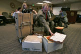 Bob Beauprez's Deputy Campaign Manager Allen Fuller (cq) (center) looks over boxes of pages filled...