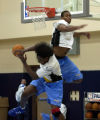 (DENVER, CO.  May 26, 2004)  Ex- CU player David Harrison blocks a shot by Cleiton Sebastiao as...