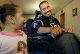 "Pete ""Petey"" Garcia (cq) shows his curious, three year old sister, Marissa Garcia his..."