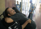 "Pete ""Petey"" Garcia (cq) is hugged by his friend Brandy Rodriguez (cq) before his..."