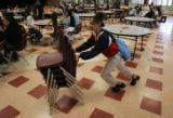 JPM023 Seventh-grader Alea Griffin, 12, puts away chairs in the cafeteria at Bruce Randolf Middle...