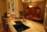 The kitchen sink leads into the dinning room at Wayne Johnson's  house at 1219 E. 10th Ave in...