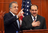 BAG101 - Iraqi Prime Minister Nouri al-Maliki, right, places his hand on his heart in thanks and...