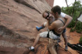 After climbing up 'Silver Spoon' with a cast on his leg Craig Smith (cq) gets a congratulatory hug...