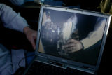 A computer screen in the hands of officer Brian Rademacher (cq) show an undercover video of a...