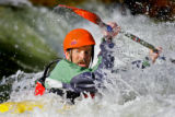 Chris Adelman (cq), 33, of Glenwood Springs paddles in the Salida Play Park one afternoon after...