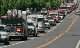 A funeral procession for fallen firefighter Lt. Rich Montoya passes south on Federal at Evans on...