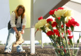 Terry Cooper (cq), mother of slain marine LCpl Thomas Slocum, lays down a ceremonial pair of boots...