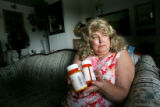 Portrait of Victoria D'Angelo (cq), 55, with some of the 22 drugs she must take at her home in...