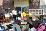 Rosa Locia (cq), stands outside with most of her belongs on the curb outside of her apartment in...