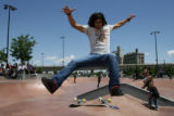 Denver resident Orion Krynen, 27, stays above his skateboard at the Denver Skate Park Sunday, June...