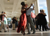 Kumasi Adoma, of Denver, left, and Igor Polk, of San Fransisco, joined dancers from around the...