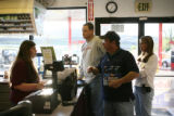 Holly, left, a store clerk at a gas station and convenience store is informed that she sold...
