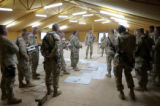 03/30/2005 Camp Udairi-Lt. Colonel Ross Brown, commander of 3ACR's Thunder Squadron, center, looks...