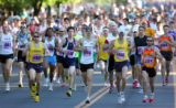 Runners in the Mens' Citizen Race including eventual winner Nelson Laux (#486), 27, of Arvada take...