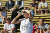 Jim Gilbert (cq) of Boulder grabs a drink of water in Folsom Field while waiting for his 11...
