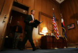 Colorado Gov. Bill Owens enters his office at the Colorado State Capitol Building in Denver on...